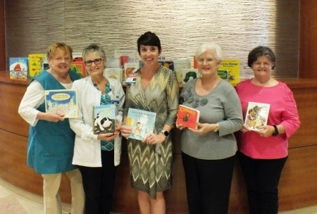 Alpha Delta Kappa members with donated books